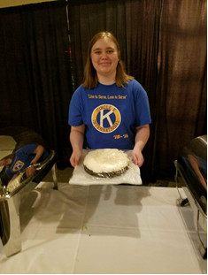 Hannah Workman can be seen showing off one of the delicious cakes to be sold at the live dessert auction!