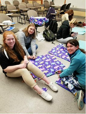 Project organizer Jenni Hickey (on the right), President Diana Bergstrom (on the left), and Hannah Workman (middle)