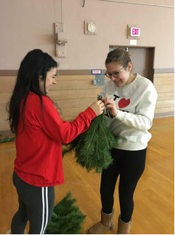 Lilly Miller and Karoline Tyne working with pieces of the big tree!